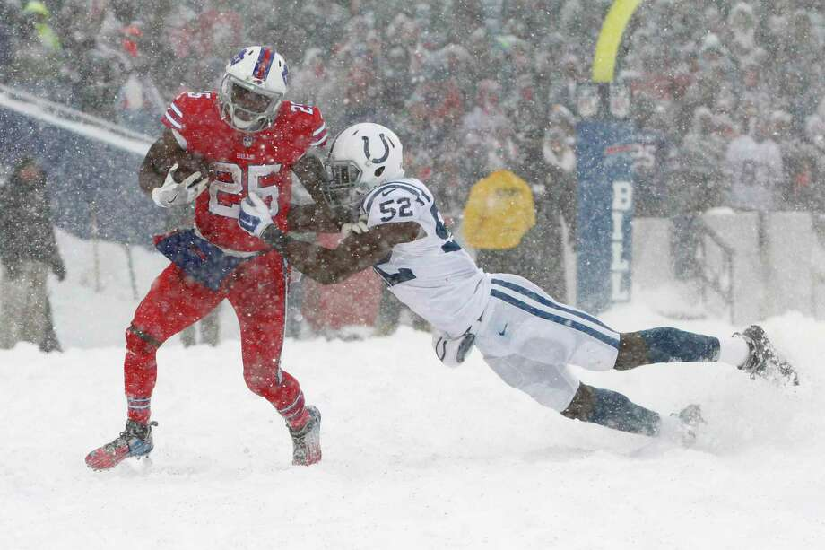 Indianapolis Colts outside linebacker Barkevious Mingo, right, tries to tackle Buffalo Bills running back LeSean McCoy during the second half of an NFL football game, Sunday, Dec. 10, 2017, in Orchard Park, N.Y. (AP Photo/Jeffrey T. Barnes) ORG XMIT: NYSW117 Photo: Jeffrey T. Barnes / FR171450 AP