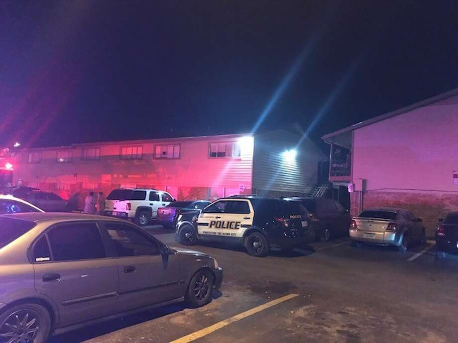 San Antonio police say two men were injured after they where shot while standing outside a South Side apartment complex Sunday night, Dec. 10, 2017. Photo: Alexandro M. Luna