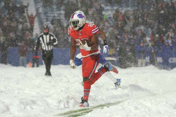 Buffalo running back LeSean McCoy dashes through the snow to score a touchdown in overtime and give the Bills a 13-7 win over Indianapolis at Orchard Park, N.Y.