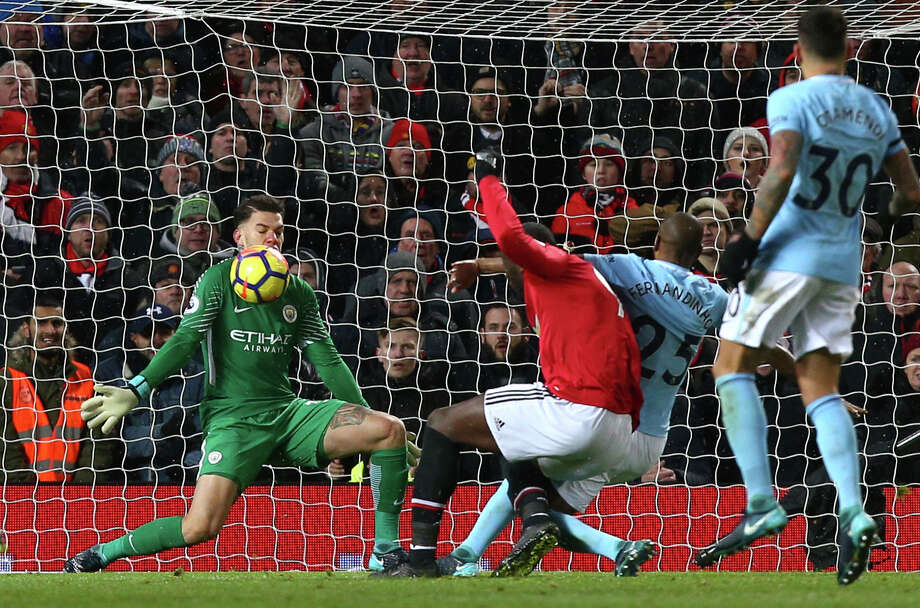 Manchester City goalkeeper Ederson, left, stops a shot from Manchester United's Romelu Lukaku, center, during Sunday's English Premier League showdown at Old Trafford in Manchester, England. Photo: Dave Thompson, STR / Copyright 2017 The Associated Press. All rights reserved.