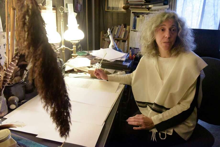 Rabbi Linda Motzkin sits in her home with a panel that is part of a Torah scroll she is writing on Thursday, Nov. 16, 2017, in Gansevoort, N.Y.  (Paul Buckowski / Times Union) Photo: Canceled / 20042091A