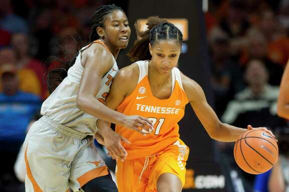 Texas' Ariel Atkins, left, scored 21 points, but it wasn't enough to offset 23 points and 13 rebounds from Tennessee's Jaime Nared in Sunday's loss.