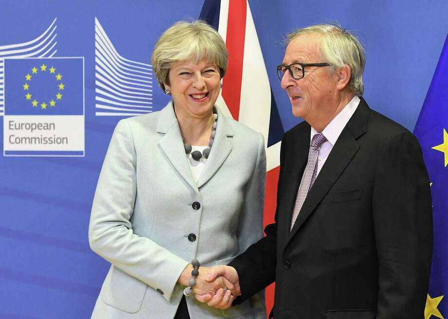 TOPSHOT - British Prime Minister Theresa May (L) is welcomed by European Commission Jean-Claude Juncker at European Commission in Brussels on December 8, 2017. / AFP PHOTO / EMMANUEL DUNANDEMMANUEL DUNAND/AFP/Getty Images Photo: EMMANUEL DUNAND / AFP or licensors