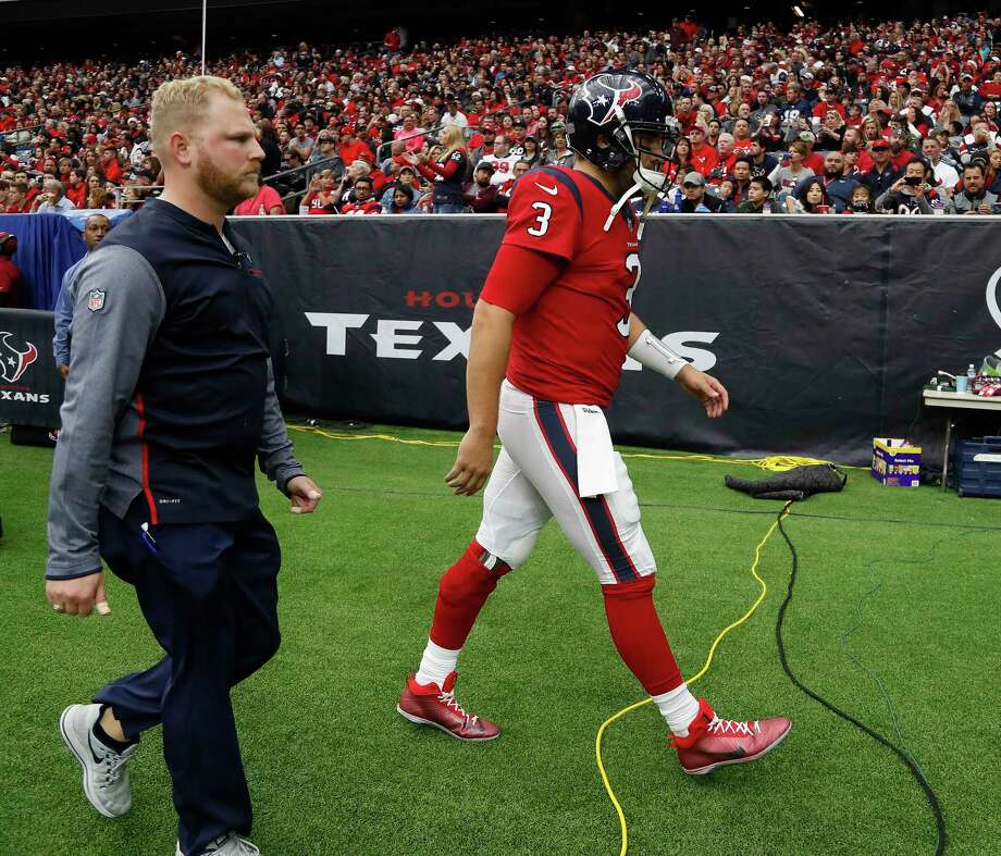 Texans quarterback Tom Savage (3) heads toward the locker room after being diagnosed with a concussion in Sunday's 26-16 loss to the 49ers at NRG Stadium. Photo: Karen Warren, Staff / © 2017 Houston Chronicle