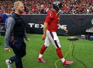 Texans quarterback Tom Savage (3) heads toward the locker room after being diagnosed with a concussion in Sunday's 26-16 loss to the 49ers at NRG Stadium.