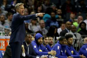 CHARLOTTE, NC - DECEMBER 06:  Head coach Steve Kerr of the Golden State Warriors yells to his team against the Charlotte Hornets during their game at Spectrum Center on December 6, 2017 in Charlotte, North Carolina.  NOTE TO USER: User expressly acknowledges and agrees that, by downloading and or using this photograph, User is consenting to the terms and conditions of the Getty Images License Agreement.  (Photo by Streeter Lecka/Getty Images)