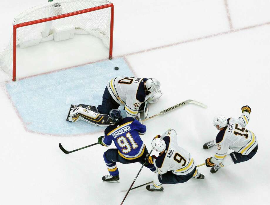 St. Louis Blues' Vladimir Tarasenko (91), of Russia, scores the winning goal past Buffalo Sabres goalie Robin Lehner, of Sweden, as Sabres' Evander Kane (9) and Jack Eichel (15) defend during overtime of an NHL hockey game Sunday, Dec. 10, 2017, in St. Louis. (AP Photo/Jeff Roberson) ORG XMIT: MOJR111 Photo: Jeff Roberson / Copyright 2017 The Associated Press. All rights reserved.