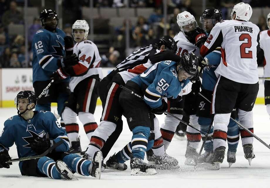 Members of the San Jose Sharks and Ottawa Senators get into a scuffle during the third period of an NHL hockey game Saturday, Dec. 9, 2017, in San Jose, Calif. (AP Photo/Marcio Jose Sanchez) Photo: Marcio Jose Sanchez, Associated Press