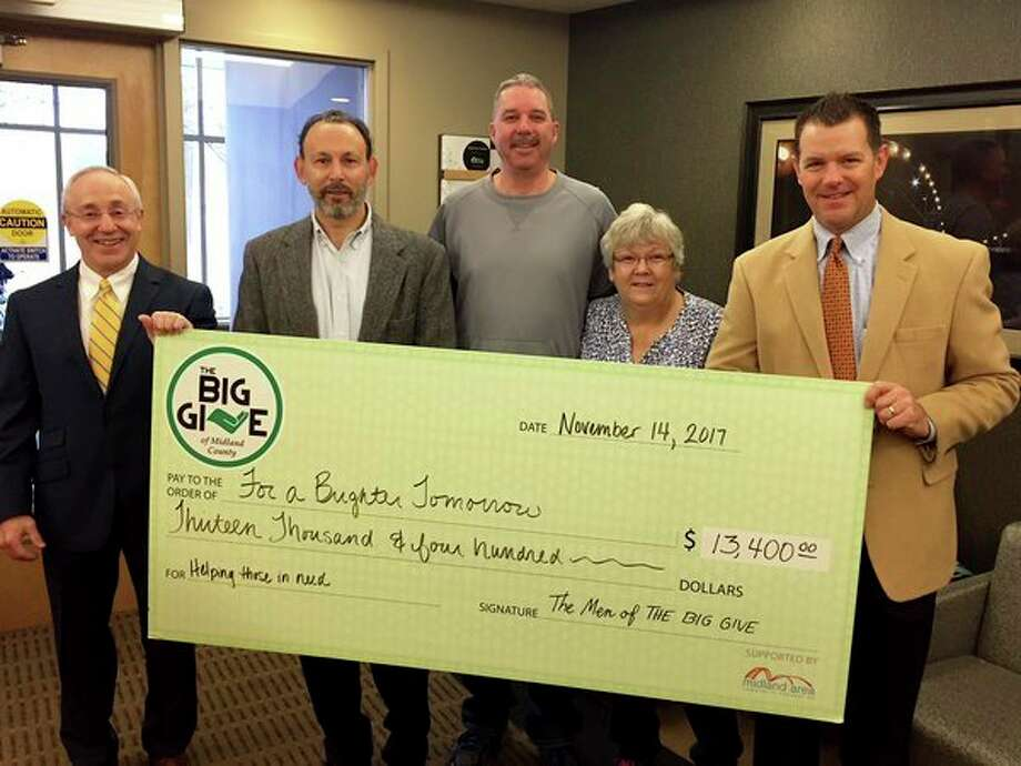From left, Jim Nigro, Jesse Traschen, Terry Hanley, Lori Wood and John Wilson participate in a check ceremony as The Big Give donates $13,400 to For A Brighter Tomorrow. (Photo provided)
