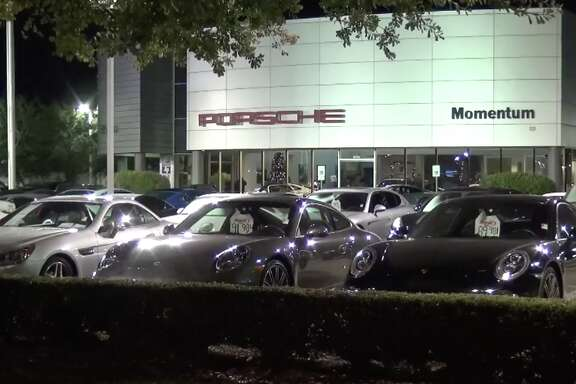 Would-be thieves crashed into a Porsche dealership showroom early Monday, police said.