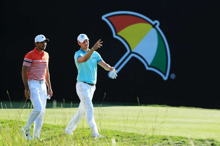 Jason Day of Australia and Martin Kaymer of Germany walk on the 18th hole during the second round of the Arnold Palmer Invitational Presented By MasterCard at Bay Hill Club and Lodge on March 17, 2017 in Orlando, Florida. Photo: Richard Heathcote/Getty Images