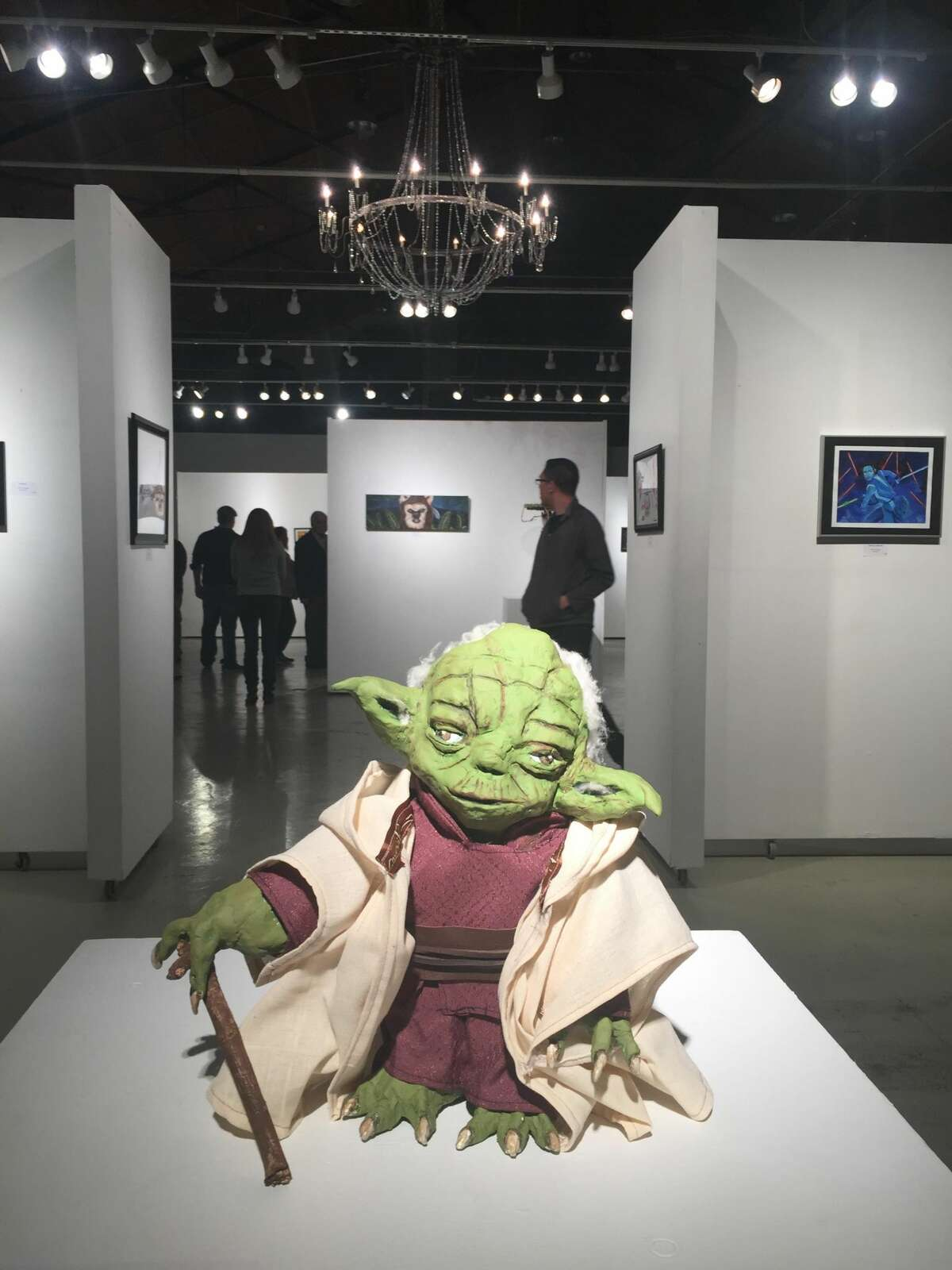 Art is exhibited during the first Art Wars art exhibit in December 2016.