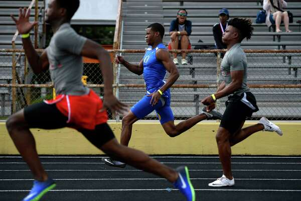 Boys runners compete in the 100 meter dash at the District 22-5A championship track meet at Nederland's Bulldog Stadium on Monday.  Photo taken Monday 4/10/17 Ryan Pelham/The Enterprise