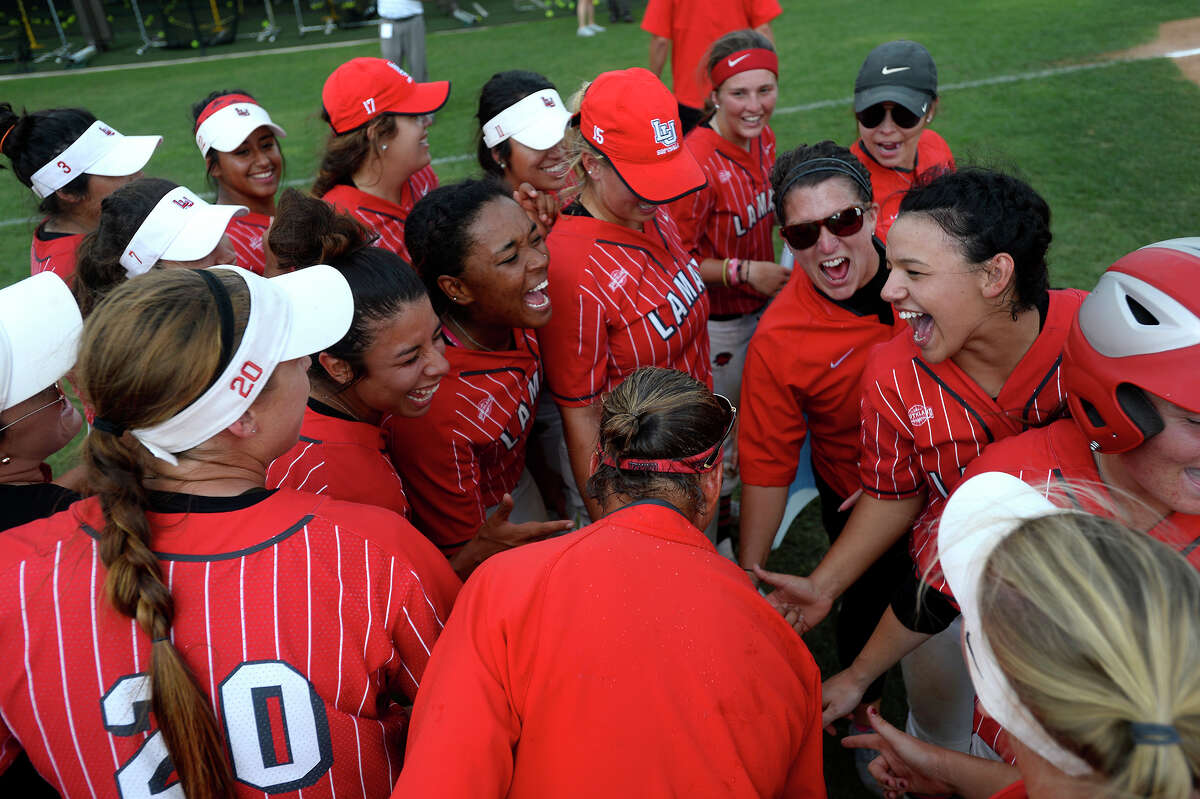 Lamar softball players and coaches cheer after they beat Louisiana-Monroe in the National Invitational Softball Championship tournament regional championship game at the Lamar Softball Complex on Thursday afternoon. Photo taken Thursday 5/18/17 Ryan Pelham/The Enterprise