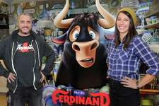 "Blue Sky Studios Animators, Pedro Miguel Sanz Garcia, left, and Lisa Allen, stand by a promotional display for the animated movie, ""Ferdinand,"" that they worked on at Blue Sky Studios in Greenwich, Conn., Tuesday, Nov. 28, 2017. ""Ferdinand"" is an animated film about a bull with a big heart that is captured, breaks free from its captors and finds its way back home. It opens in theaters on December 15, 2017."