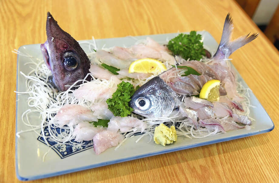 A plate of sashimi served in Marukichi Shokudo reveals the oddly shaped heads of two of the region's deep-sea fish varieties. Photo: Japan News-Yomiuri / Japan News-Yomiuri