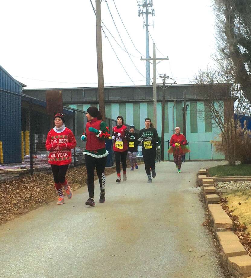 Competitors battle the cold Saturday in Trinity Lutheran Ministries' second annual CHRISTmas Ugly Sweater Dash 5K. The event featured a 5K race, family fun run, Christmas-themed photo booth, holiday-themed inflatables, an ugly sweater contest, and hot chocolate and cookies for all participants at the finish line. All of the proceeds from the race will stay in the community, as 20 percent of the registration costs will be donated to the Glen-Ed Food Pantry and Neighbors In Need program. Photo: Bill Craft • For The Intelligencer
