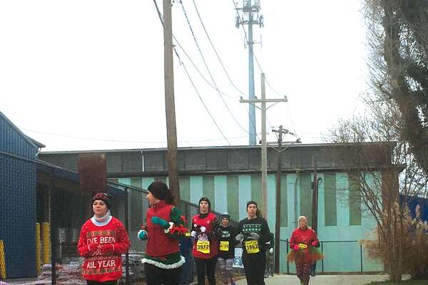 Competitors battle the cold Saturday in Trinity Lutheran Ministries  its second annual CHRISTmas Ugly Sweater Dash 5K. The event featured a 5K race, family fun run, Christmas-themed photo booth, holiday-themed inflatables, an ugly sweater contest, and hot chocolate and cookies for all participants at the finish line. All of the proceeds from the race will stay in the community, as 20 percent of the registration costs will be donated to the Glen-Ed Food Pantry and Neighbors In Need program.
