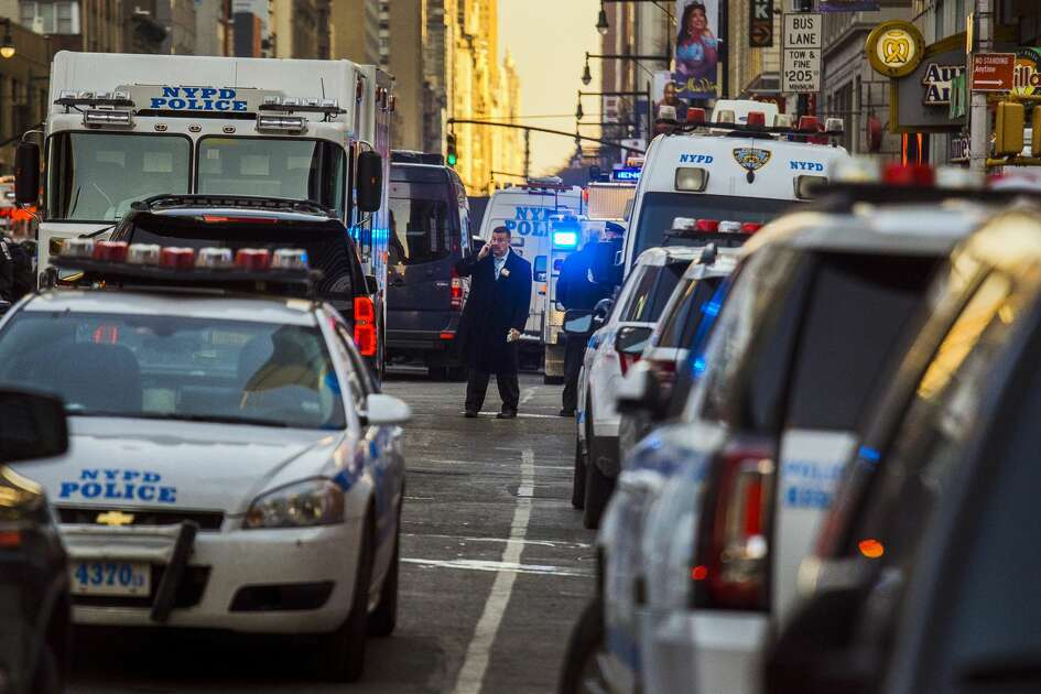 Police block a street by Port Authority Bus Terminal near New York's Times Square following an explosion on Monday, Dec. 11, 2017. Police say the explosion happened in an underground passageway under 42nd Street between Seventh and Eighth Avenues.