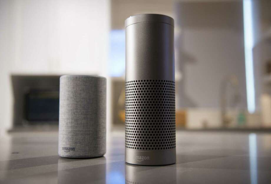 The Amazon.com Echo (left) and Echo Plus in Seattle, Washington, on Sept. 27, 2017. Photo: Bloomberg Photo By Daniel Berman. / © 2017 Bloomberg Finance LP