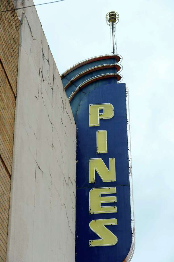 The retro neon sign on the Pines Theater in downtown Silsbee. The theater has been closed since Harvey with no date to reopen set.  Photo taken Tuesday 10/3/17 Ryan Pelham/The Enterprise Photo: Ryan Pelham / ©2017 The Beaumont Enterprise/Ryan Pelham