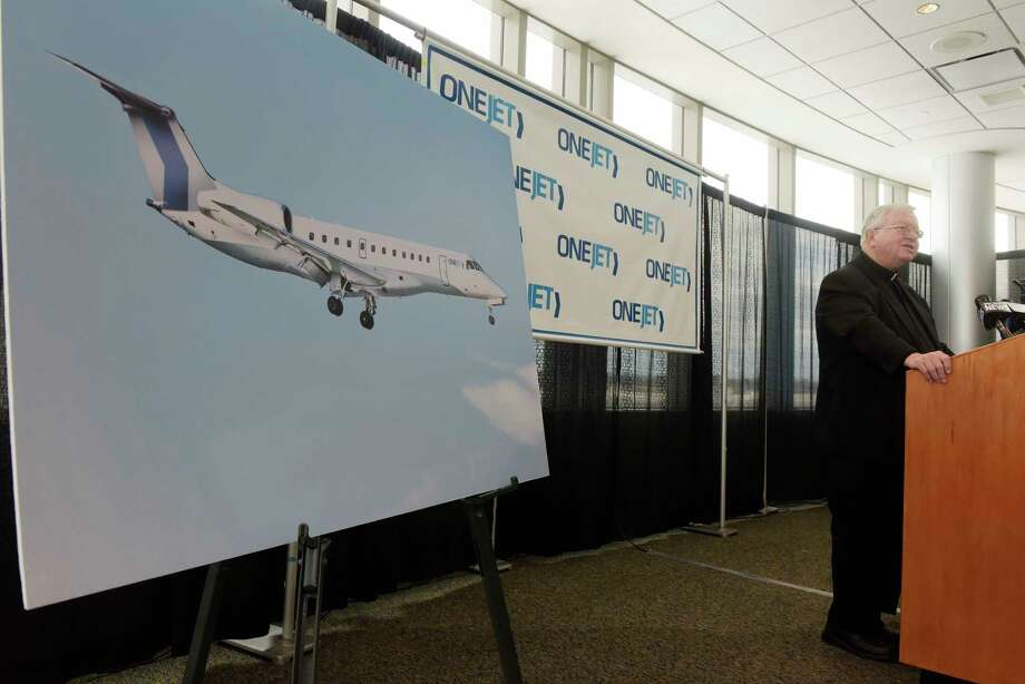 Father Kenneth Doyle, chairman of the Albany County Airport Authority addresses those gathered during an event at the Albany International Airport on Monday, Dec. 11, 2017, in Colonie, N.Y.  It was announced at the event that OneJet will begin service between Albany and Buffalo on February 1st. (Paul Buckowski / Times Union) Photo: PAUL BUCKOWSKI, Albany Times Union / 20042368A