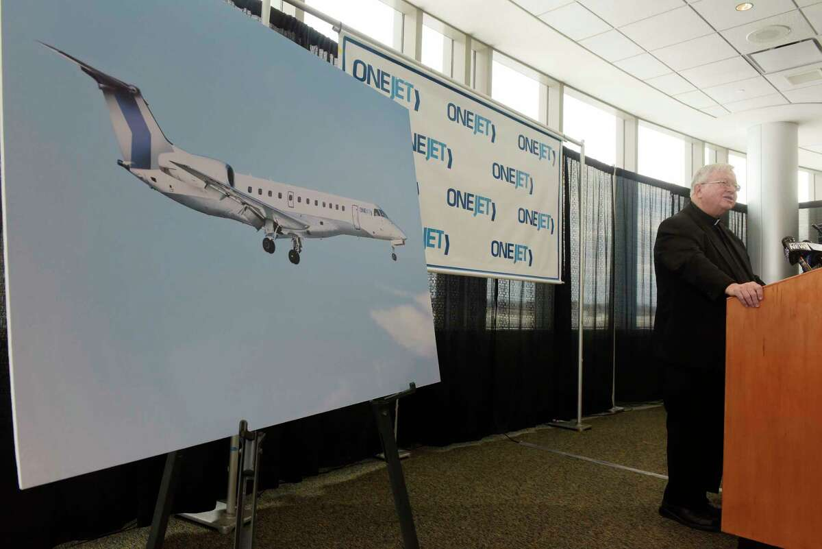 Father Kenneth Doyle, chairman of the Albany County Airport Authority addresses those gathered during an event at the Albany International Airport on Monday, Dec. 11, 2017, in Colonie, N.Y. It was announced at the event that OneJet will begin service between Albany and Buffalo on February 1st. (Paul Buckowski / Times Union)