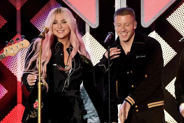 INGLEWOOD, CA - DECEMBER 01:  Kesha (L) and Macklemore perform onstage during 102.7 KIIS FM's Jingle Ball 2017 presented by Capital One at The Forum on December 1, 2017 in Inglewood, California.