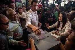 Salvador Nasralla, Patriotic Alliance Party (Alianza) 2017 Honduran presidential candidate (center), casts a ballot at a polling station during the presidential election in Tegucigalpa, Honduras, on Nov. 26, 2017.