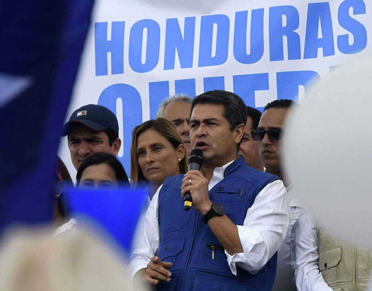 Honduran President Juan Orlando Hernandez addresses supporters during a march on Dec. 6, 2017 in Tegucigalpa. The Central American nation of 10 million has plunged into uncertainty punctuated with clashes since the Nov. 26 election pitting Hernandez against challenger Salvador Nasralla, with both sides claiming victory. (AFP/Getty Images)