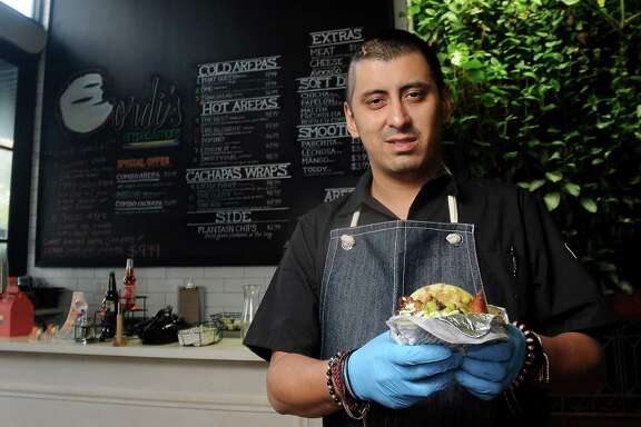 Chef/owner David Guerrero at Gordi's Arepas & More at The Conservatory downtown Wednesday Nov.29,2017. (Dave Rossman Photo)