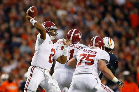 Alabama quarterback Jalen Hurts throws the ball during the second half of the Nov. 25, 2017 Iron Bowl game, in Auburn, Ala. The Associated Press voters prefer Alabama over Ohio State. In the final Top 25 of the regular season, the Crimson Tide was No. 4 and the Buckeyes were No. 5.