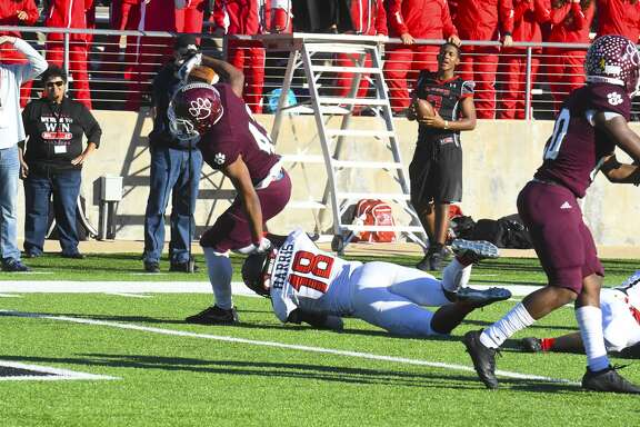 CyFair vs Langham Creek Football Playoff  Caption CyFairs  No 43 RB Trenton Kennedy  Runs and stretches for his second touchdown ,   at  the playoff game ,    Saturday 12/9'2017 , .at the Berry Center.