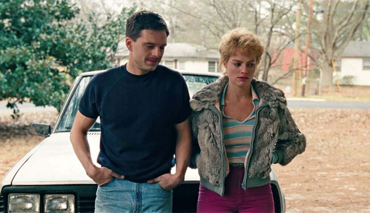 """This image released by Neon shows Sebastian Stan as Jeff Gillooly, left, and Margot Robbie as Tonya Harding in a scene from """"I, Tonya."""" On Monday, Dec. 11, 2017, Robbie was nominated for a Golden Globe for best actress in a motion picture comedy or musical for her role in the film. The 75th Golden Globe Awards will be held on Sunday, Jan. 7, 2018 on NBC. (Neon via AP)"""
