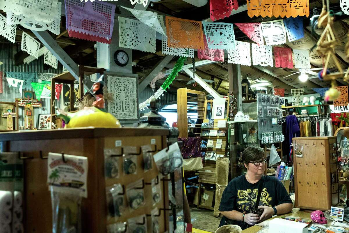 Joanne Smart shops at Corazon Artes Populares on Tuesday, Nov. 21, 2017, in Houston. After 20 years, Corazon will close its doors at the start of the new year after the owner of the century old building sold the property to build townhomes. ( Brett Coomer / Houston Chronicle )
