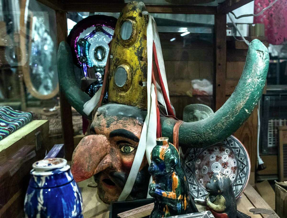 A mask is on display at Corazon Artes Populares on Tuesday, Nov. 21, 2017, in Houston. After 20 years, Corazon will close its doors at the start of the new year after the owner of the century old building sold the property to build townhomes. ( Brett Coomer / Houston Chronicle )