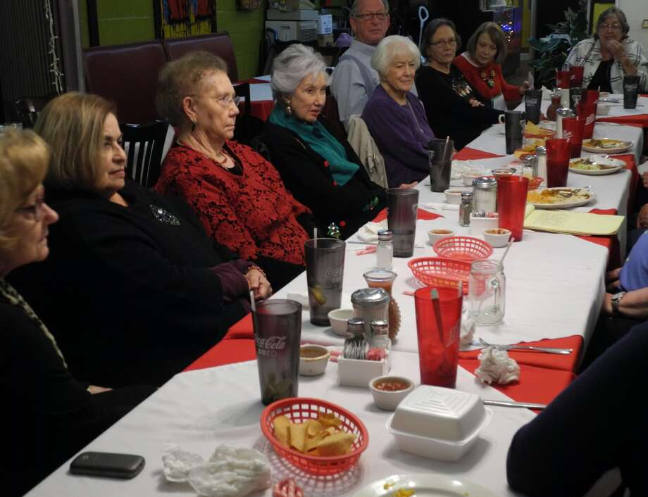 The Hale County Historical Commission and the Hi-Plains Genealogy Society shared Christmas memories at a joint celebration at Old Mexico last week. Shown are Alice Sawayer, Elva Hipolito, June Wells, Carolyn Courtney, Pat Ryan, Carl and Renee Williams, Linda Milner Shipp and Maxine Davis. Photo: Gail M. Williams