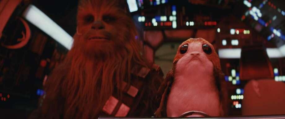Star Wars: The Last Jedi..L to R: Chewbacca (Joonas Suotamo) and a Porg. Photo: Industrial Light & Magic, Lucasfilm Ltd.