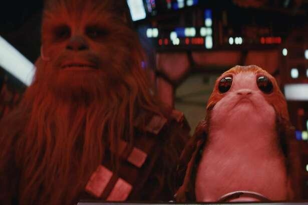 Star Wars: The Last Jedi..L to R: Chewbacca (Joonas Suotamo) and a Porg.