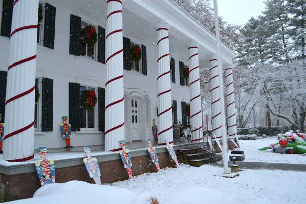 Saturday's snow added to the holiday setting at A Visit to Santa's House, held at the Burr Homestead, Saturday, Dec. 9, 2017, in Fairfield, Conn.