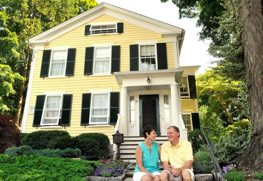 Mary and Paul English sit in front of their house on Greenwood Avenue in Bethel where P.T. Barnum was born 200 years ago. Photographed on Tuesday, June 29, 2010. Photo: Michael Duffy / The News-Times