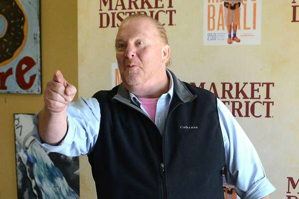 Mario Batali arrived in his signature outfit: a black vest over a shirt with rolled-up sleeves, Bermuda shorts, blue socks and orange Crocs. (Lake Fong/Pittsburgh Post-Gazette/TNS)