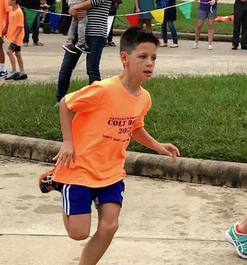 Ryan Weatherwax joins the fun of the fourth annual Colt Bolt Fun Run and Fundaiser at Pattison Elementary. Photo: Lindsey Klingensmith