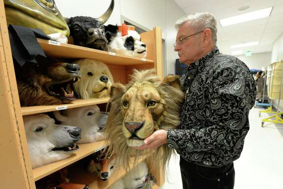 Wardrobe Supervisor Donald Simms examines animal masks as preparations begin for Houston Ballet's production of The Nutcracker at Smart Financial Centre on Wednesday, December 6, 2017 in Sugar Land, TX.