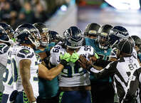 JACKSONVILLE, FL - DECEMBER 10:  Seattle Seahawks defensive lineman Quinton Jefferson (99) has a heated exchange with Jacksonville Jaguars offensive lineman during the game between the Seattle Seahawks and the Jacksonville Jaguars on December 10, 2017 at EverBank Field in Jacksonville, Fl. (Photo by David Rosenblum/Icon Sportswire via Getty Images)