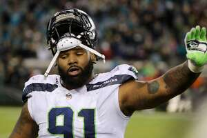 JACKSONVILLE, FL - DECEMBER 10:  Sheldon Richardson #91 of the Seattle Seahawks walks off the field during the second half of their game against the Jacksonville Jaguars at EverBank Field on December 10, 2017 in Jacksonville, Florida.  (Photo by Sam Greenwood/Getty Images)