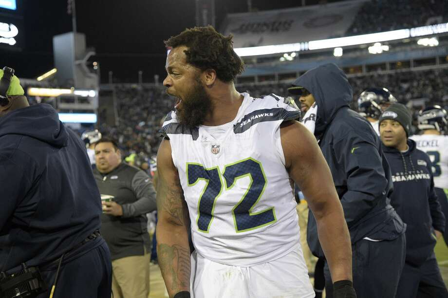 Seattle Seahawks defensive end Michael Bennett (72) argues with teammate defensive end Marcus Smith on the sideline during the second half of an NFL football game against the Jacksonville Jaguars Sunday, Dec. 10, 2017, in Jacksonville, Fla. The Jaguars won 30-24. (AP Photo/Phelan M. Ebenhack) Photo: Phelan M. Ebenhack/AP