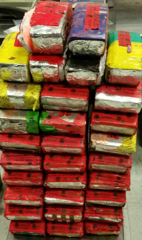U.S. Customs and Border Protection officers recently seized more than 200 pounds of crystal methamphetamine and heroin with a combined street value of $4 million hidden inside a vehicle. The drivers and passengers were arrested. Photo: Courtesy Photo/CBP