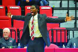 SIUE men's basketball coach Jon Harris shouts out instruction from the sideline during a game against South Alabama on Sunday inside the Vadalabene Center.
