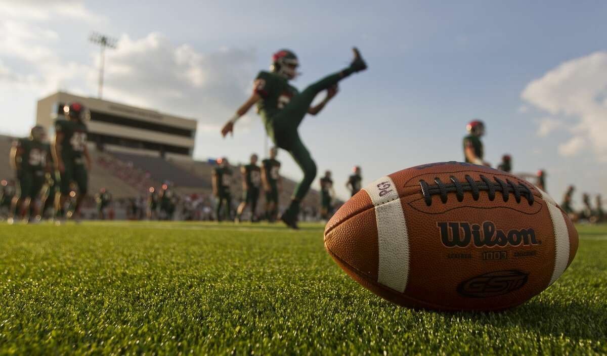The Woodlands players warm up before a non-district high school football game against George Ranch at Woodforest Bank Stadium, Friday, Sept. 22, 2017, in Shenandoah.